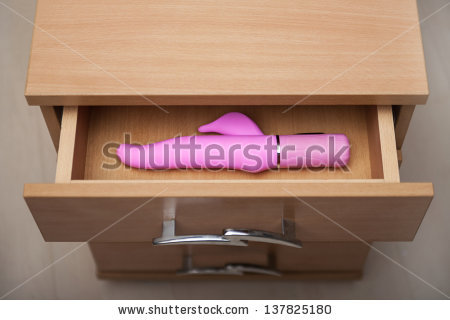 stock-photo-sex-toy-in-open-countering-bedside-table-137825180