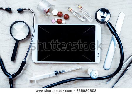 stock-photo-tablet-pc-with-medical-objects-on-a-desk-as-a-metaphor-for-electronic-diagnostic-or-healthcare-325080803